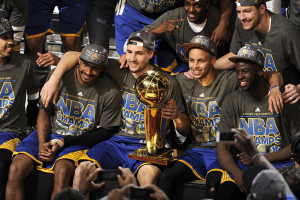 CLEVELAND, OH - JUNE 16: The Golden State Warriors celebrate winning the 2015 NBA Finals after a win against the Cleveland Cavaliers in Game Six of the 2015 NBA Finals at The Quicken Loans Arena on June 16, 2015 in Cleveland, OH. NOTE TO USER: User expressly acknowledges and agrees that, by downloading and/or using this Photograph, user is consenting to the terms and conditions of the Getty Images License Agreement. Mandatory Copyright Notice: Copyright 2015 NBAE (Photo by David Liam Kyle/NBAE via Getty Images)